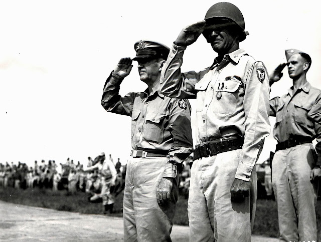 US Army bigwigs review the troops at Lipa Airstrip, 1945.  Image source:  United States National Archives.