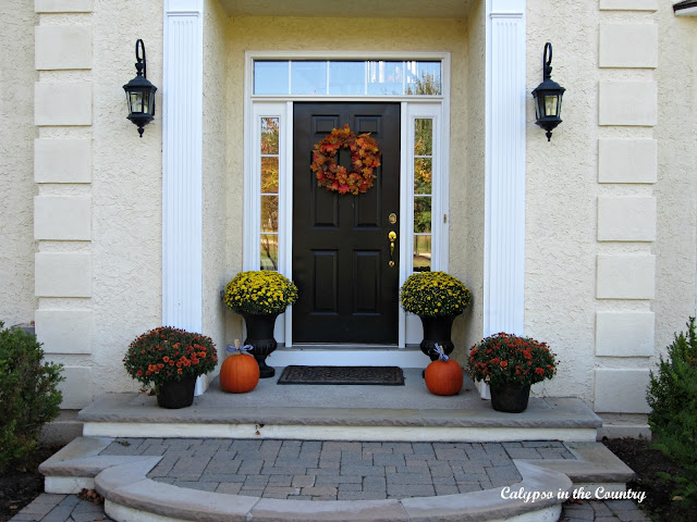 Fall porch with faux wreath
