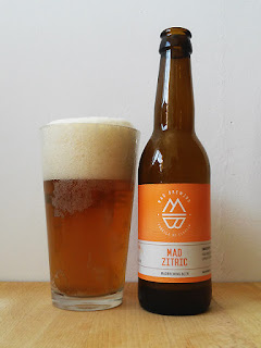 Mad Brewing Mad Zitric Pale Ale dorado y en botella