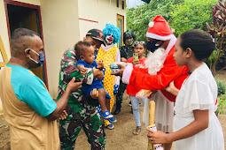Satgas Yonif 125 Berbagi Kado Natal Natal Sinterklase ke Anak-anak di Naukenjerai
