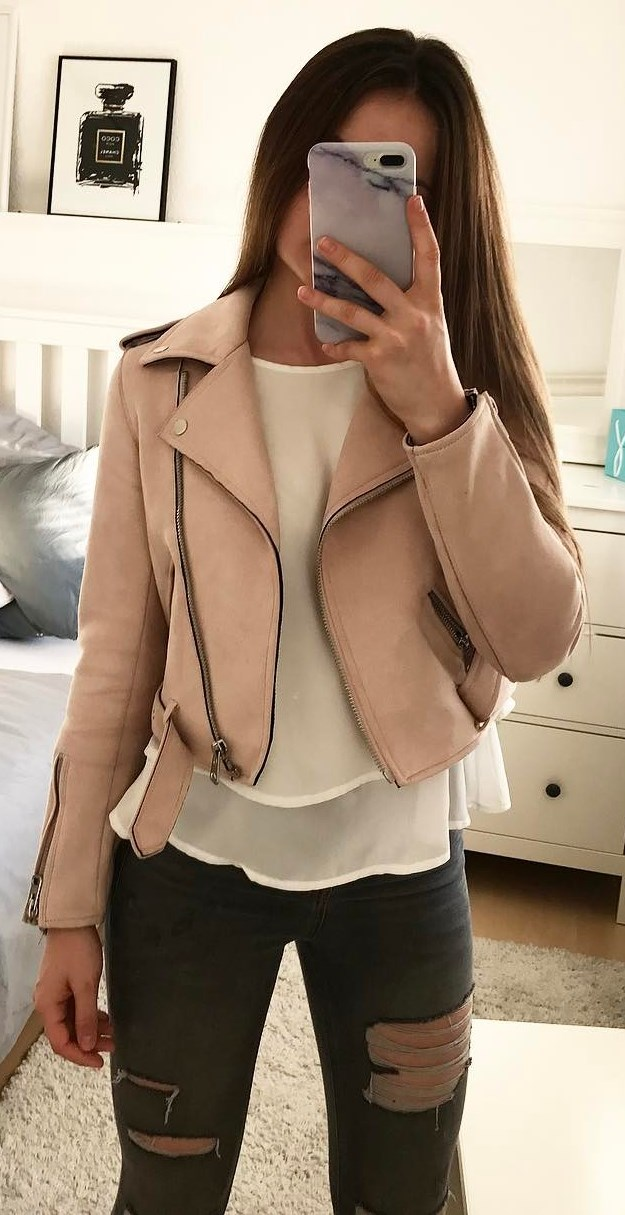 what to wear with a pink biker jacket : blouse + ripped jeans