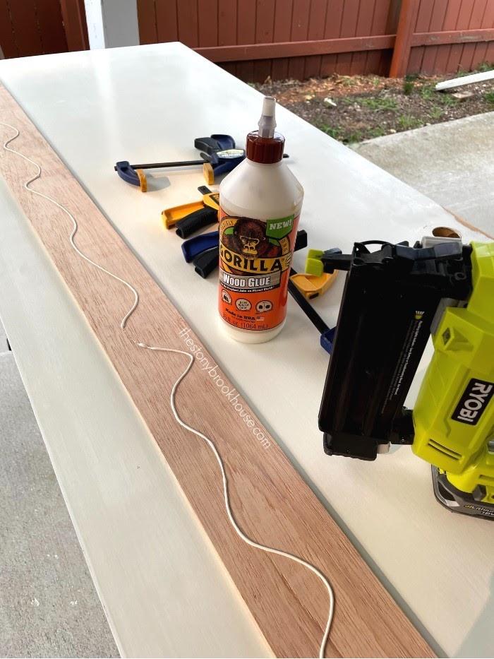 Attaching underlayment strips to flat panel door