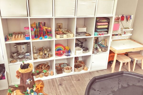 child led continuous provision playroom  learning though play play shelves and ikea kallax and  flisat table