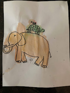 A drawing of a yellow elephant with a turtle on its back.