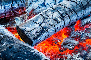 Smoke burns out when wood is burned, but why not coal burn