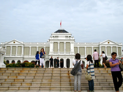 Istana Main Building Front Door with tourist taking picture
