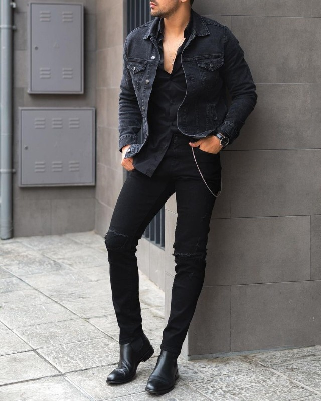 Man in Chelsea boots, jeans, shirts and Denim jacket.