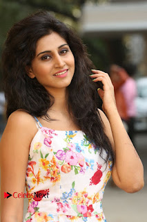 Actress Shamili Stills in Floral Short Dress at Sree Ramaraksha Song Launch 0034