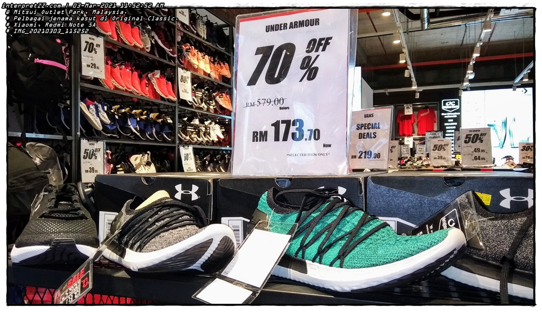 The picture shows the price for a pair of Under Armor shoes falling to MYR 173.70 from the original price of RM 579.00 through the promotional price at the Original Classic store. It feels like I want to buy it but there is no need. # Wednesday, 3 March 2021, 11:52 # 20210303 # IMG_20210303_115252.jpg # Xiaomi Redmi Note 5A smartphone camera # Location at Mitsui Outlet Park KLIA in Malaysia #
