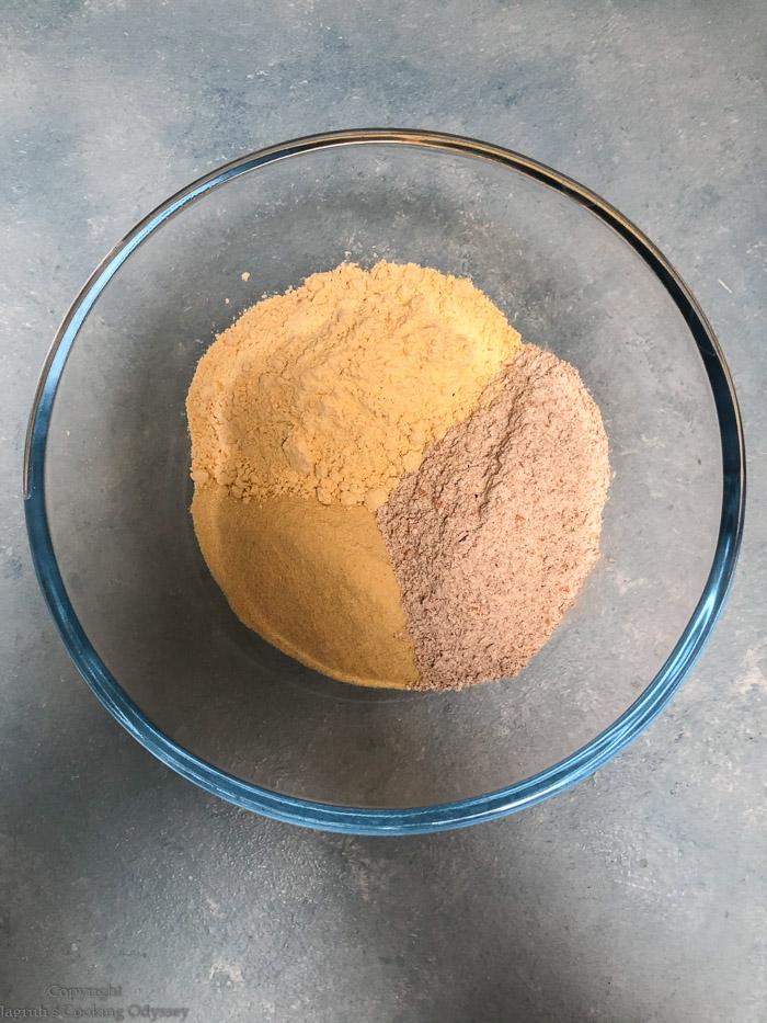 making microwave churma na ladwa step 1 flour, besan, semolina and bowl