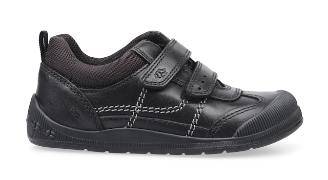 a black pair of velcro trainer type school shoes