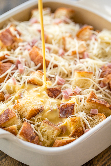 Ham & Cheese Croissant Casserole - love this overnight breakfast casserole! Ham, croissants, swiss cheese, eggs, half-and-half, dry mustard, honey, salt and pepper. Assemble the night before and bake in the morning. Great way to use up any leftover holiday ham!! #casserole #breakfast #croissant #makeaheadcasserole