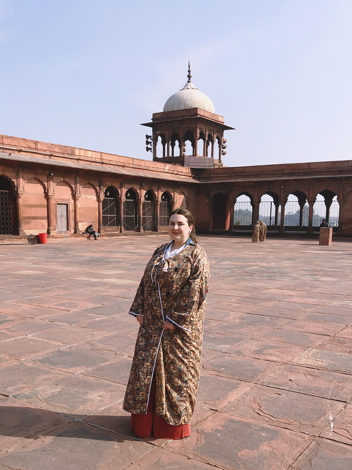 Plus size woman at Jama Masjid wearing the gown given out for modesty