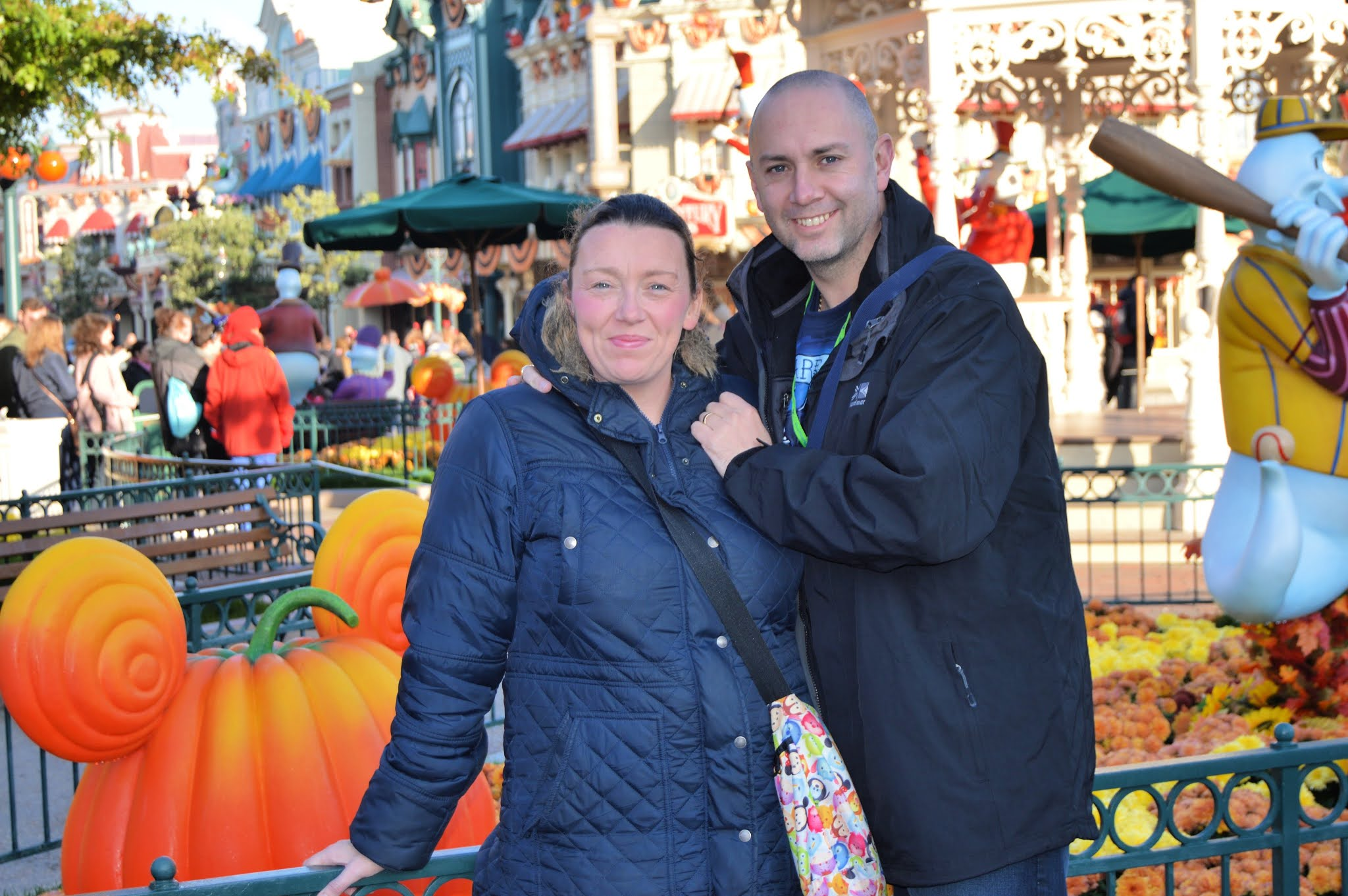 a couple by a Pumpkin at Disneyland Paris