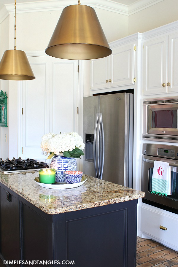 white kitchen cabinets, black kitchen island, brass pendant lights, savoy alden brass pendants