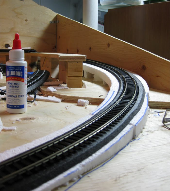 Foam trackbed with the first length of track installed on the right side of my layout
