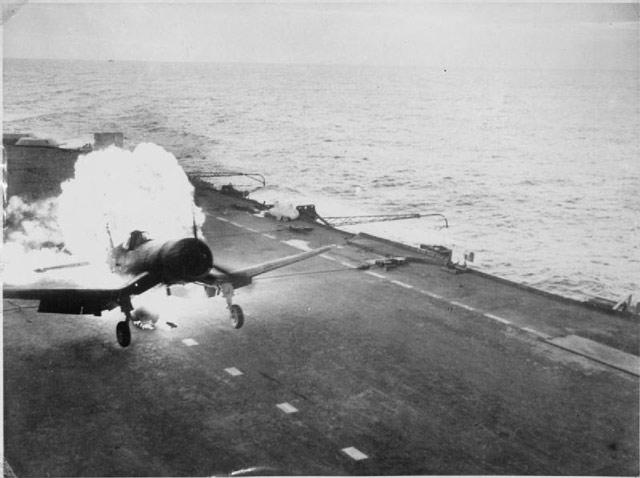 Corsair fighter landing on an armored Royal Navy carrier during World War II worldwartwo.filminspector.com