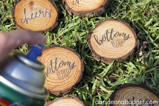 These DIY Wooden Coasters Wedding Favors are perfect for your rustic wedding. You can use actual fresh tree or purchased unfinished wood slices to make them.