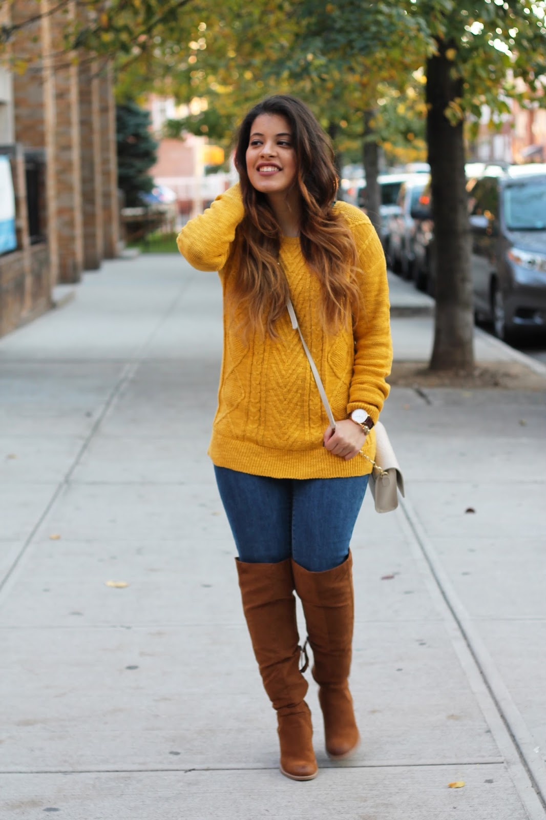 Mustard Yellow Pullover Sweater and Brown Over the Knee Boots.