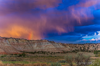 Cramer Imaging's fine art landscape photograph of dramatic clouds and a rainbow above the Cannonville Utah landscape