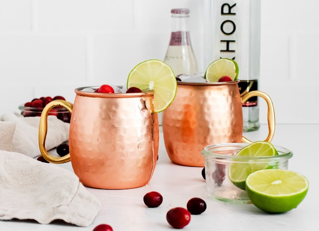 Two cups with ice and garnishes