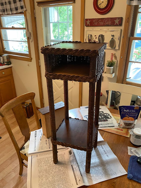 Photo of vintage wicker plant stand