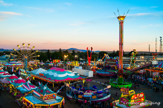 Cramer Imaging's professional quality fine art photograph of aerial view of Eastern Idaho State Fair carnival in Blackfoot, Bingham, Idaho at sunset