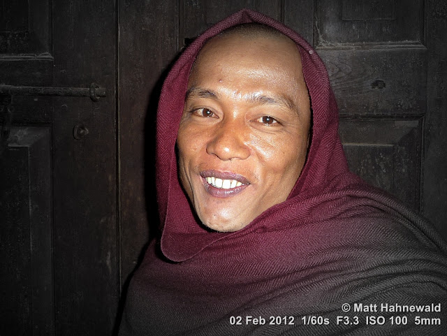 Burma, Myanmar, Inle Lake, Burmese monk, Burmese man, people, street portrait, smiling Buddhist monk, maroon robe, hood, focal black and white