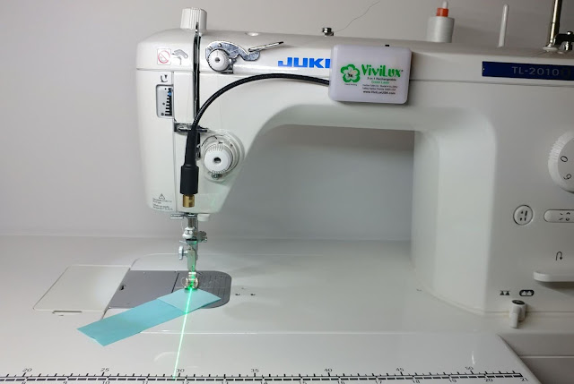 Using a sewing machine laser for stitch 'n flip corners