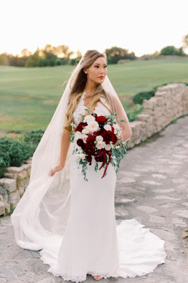 bride with big burgundy bouquet
