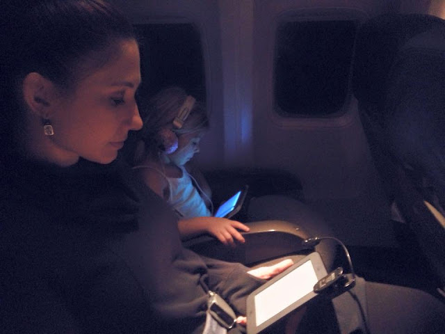 mom and daughter on plane