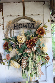 rustic lasso wreath with tan and cream flowers