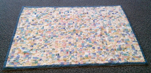 Postage stamp quilt made from curtain sample book