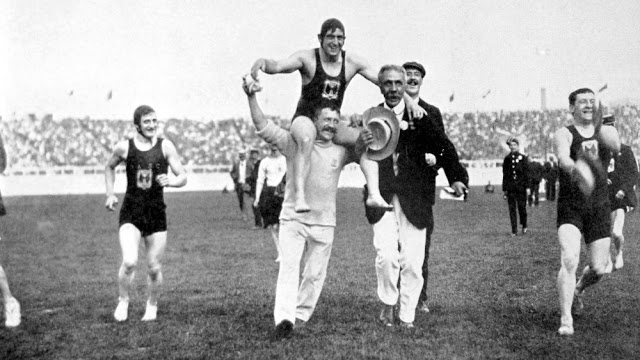 Great Britain's Henry Taylor is carried shoulder-high around the White City stadium after winning gold in Freestyle swimming the 1908 Olympics Your Russians are missing and other stories about past Olympics. marchmatron.com