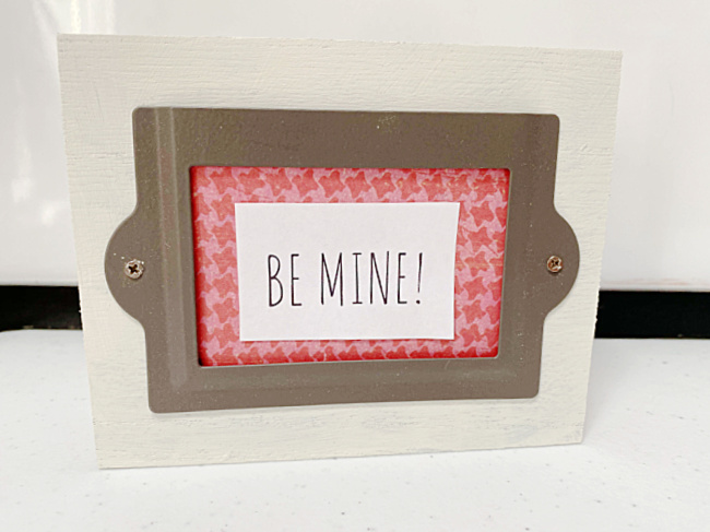 Sign with BE MINE sign in label