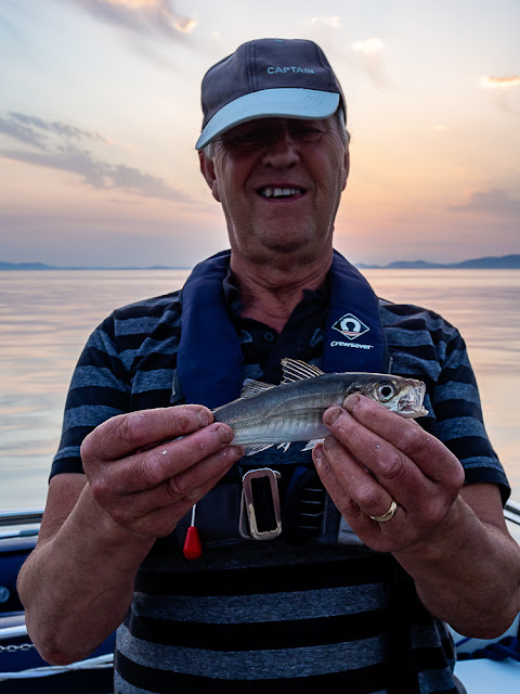 Photo of Phil with the small bass he caught on this trip