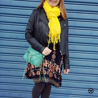 awayfromblue Instagram layering a floral swing dress for winter with bright accessories