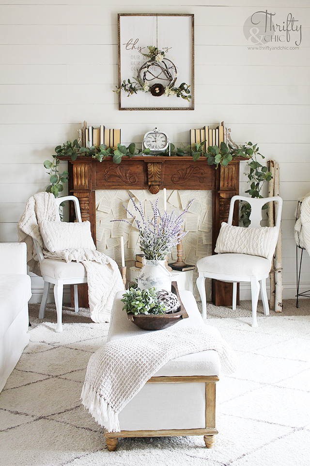 Spring living room decor and decorating ideas. Neutral farmhouse decor. White and wood living room. Faux fireplace decorating ideas. Spring mantel decor. Spring mantle decor. How to decorate for spring. Spring decorating tips.