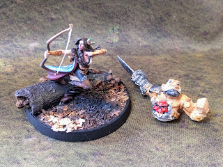 On the left: A miniature from the start of the year. On the right: My oldest painted mini