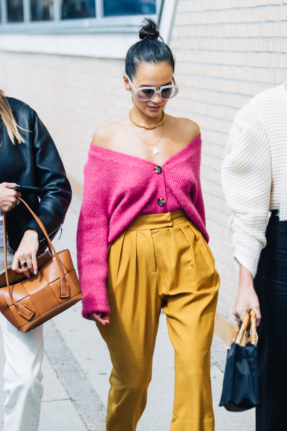 Fresh Way to Wear V-Neck Cardigan — Street style fall outfit idea with a pink caridgan off-the-shoulder and high-waisted pants