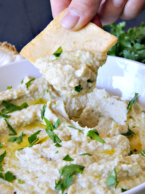 Creamy Artichoke and White Bean Dip - Switch up your normal hummus routine with this delicious artichoke and white bean dip. Eat it with pita chips, fresh veggies, or even on your sandwiches in place of the mayo. From www.bobbiskozykitchen.com