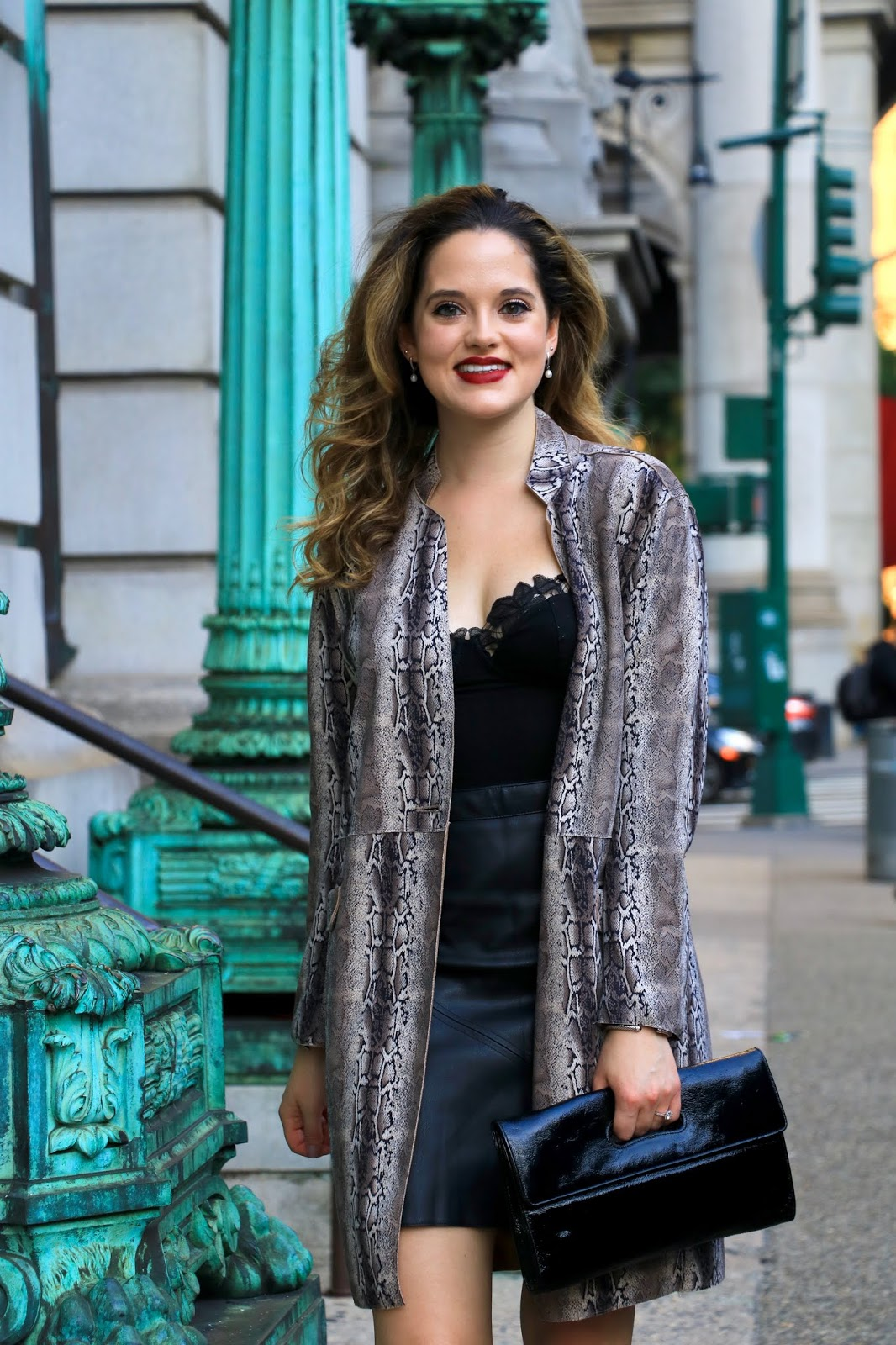 Nyc fashion blogger Kathleen Harper wearing a fall outfit with a snake print jacket.