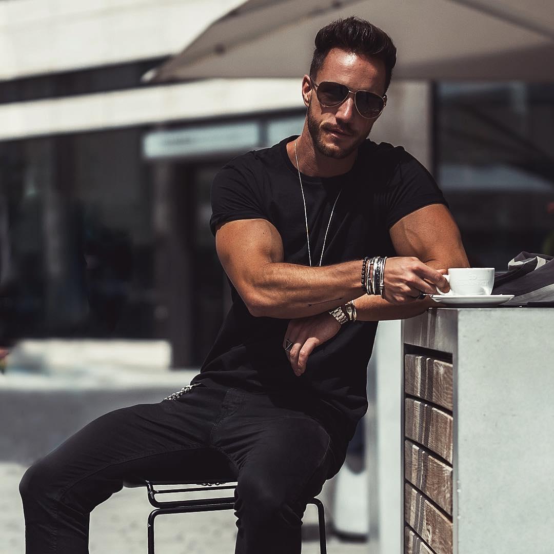 luxurious-man-sunglasses-gentleman-black-clothes-drinking-coffee