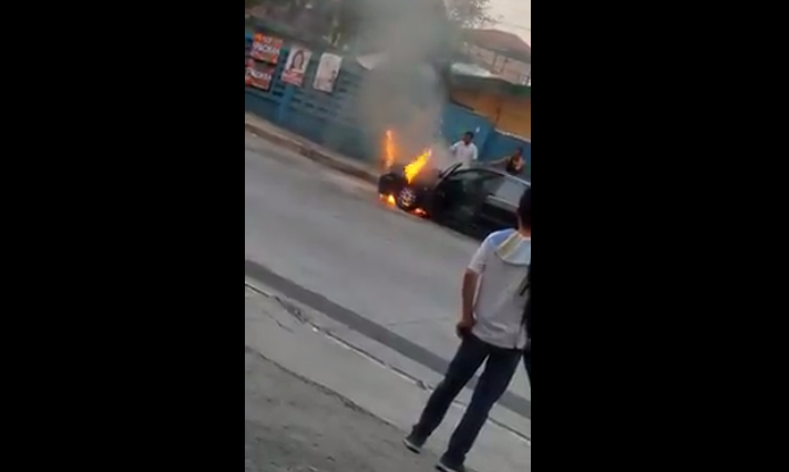 Car Burns Down at Street