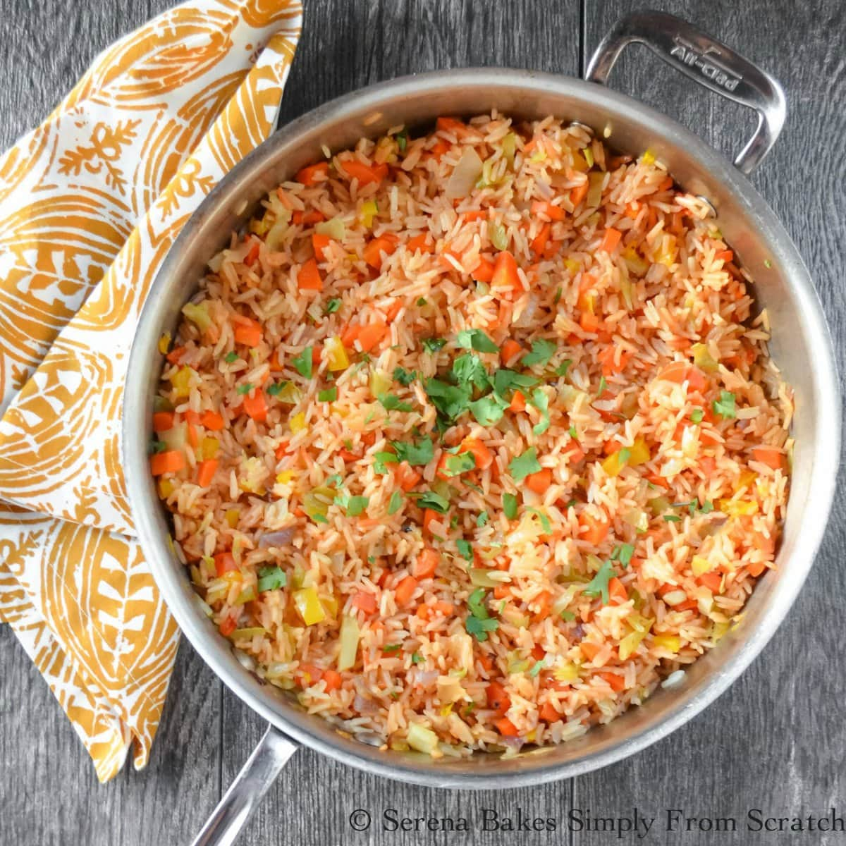 Mexican Rice recipe that tastes just like what you find at your favorite Mexican Restaurant. Easy to make, great flavors, and the whole family will love it! A favorite recipe for Mexican Rice from Serena Bakes Simply From Scratch.