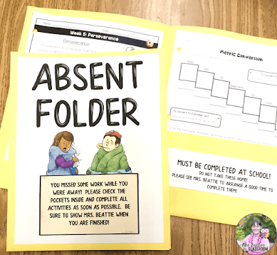 Photo of classroom Absent Folders with one open to show inside pockets.