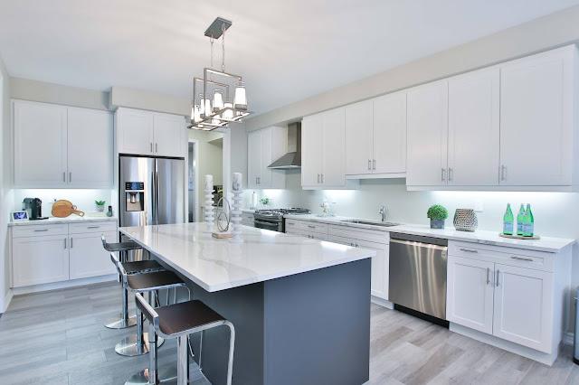 A white kitchen with grey vinyl flooring
