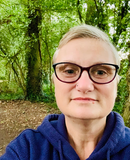 madmumof7 wearing glasses in woodland