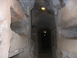 Inside one of the long passageways in the Catacomb of Callixtus on the Appian Way, where Julius I was first buried