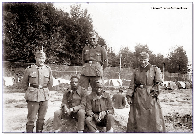 Germans with North African most probably Senegalese French POW  St. Cloud